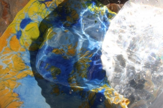 Photograph using surfaces of abstract painting, marble and mirror
